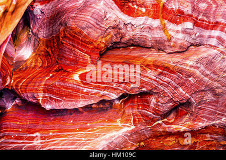 Red Rock Abstract Petra Jordan  Built by the Nabataens in 200 BC to 400 AD.  Rose Red canyon walls create many abstracts - Stock Photo