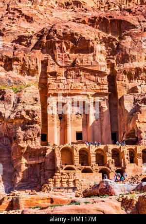 Rock Tomb Arch Tourists Petra Jordan.  Built by the Nabataens in 200 BC to 400 AD. - Stock Photo