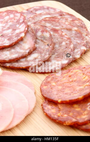 Classic delicious pizza ingredients on nice table setting or kitchen work table - Stock Photo