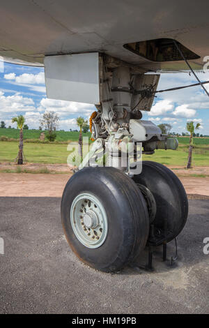 close up of big airplane wheels and landing gear - Stock Photo