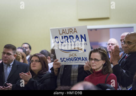 Uniondale, USA. 30th Jan, 2017. Audience members clap and hold up signs supporting Laura Curran, candidate for Nassau - Stock Photo