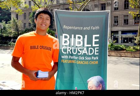 New York City - August 24, 2009:  Korean youth  handing out literature for a Bible Crusade on Broadway at West 79th - Stock Photo