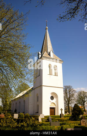 A white church in the countryside, with churchyard and gravestones, Lackalanga, Sweden, May 6, 2015 - Stock Photo