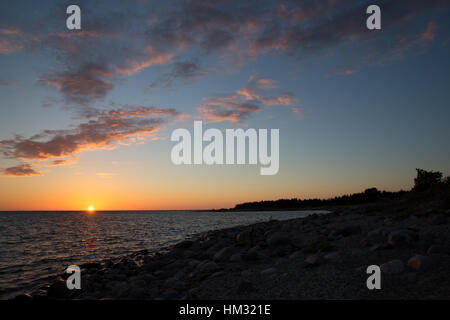 Sunset on the beach seen from the lighthouse, Kihnu Island, Estonia - Stock Photo
