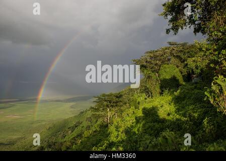 Rainbow over Ngorongoro Crater in Tanzania, Africa - Stock Photo