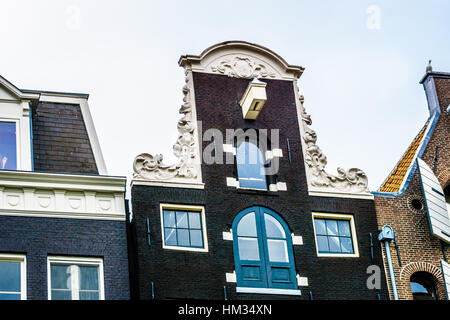 Neck Gables of Historic Houses along the Canals in the Old City Center of Amsterdam in the Netherlands - Stock Photo