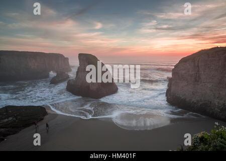 Misty Sunset At Shark Fin Cove. Shark Tooth Beach, Davenport, California, USA. - Stock Photo