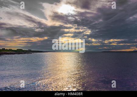 Evening falls over Atlantic Ocean at Orkneys. - Stock Photo