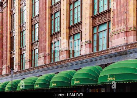 London, UK - October 19, 2016 - Facade of Harrods, an upmarket department store - Stock Photo