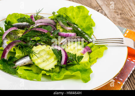 Fresh vegetable salad with anchovies - Stock Photo