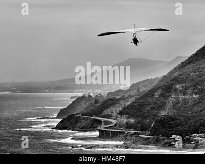 Hand gliding from Stanwell tops along coastline of NSW - Grand pacific drive and Sea Cliff Bridge. Wind powered - Stock Photo