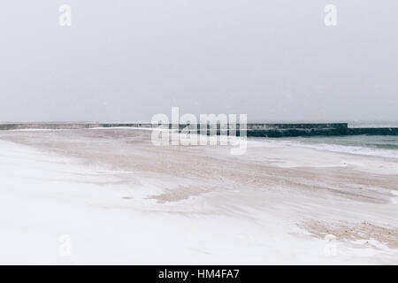 Beach during a blizzard and snowfall, minimalist landscape, soft focus - Stock Photo