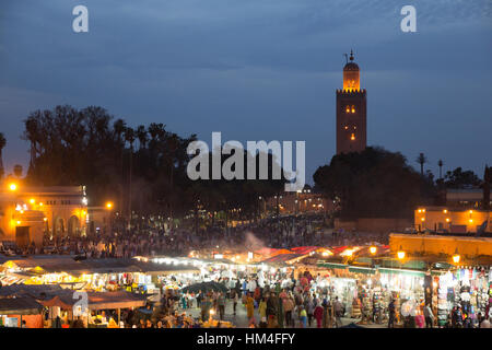 Evening view on the Djemaa el Fna square and the Koutoubia mosque, Marrakech, Morocco - Stock Photo