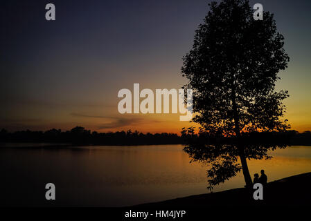 Sunset at one of the many lakes in Angkor Siem Riep province Cambodia - Stock Photo