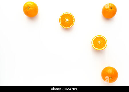 Whole and Halved Oranges on White - Stock Photo