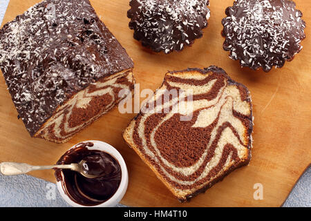 Swirl cake with chocolate on wooden board - Stock Photo