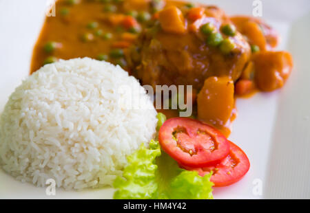 Chicken Curry served with rice - Stock Photo