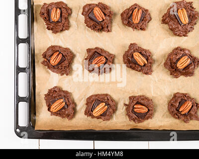 Setting Pecan Chocolate Cookies In Tray Before Cooking In Oven - Stock Photo