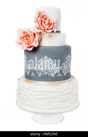 beautiful grey and white weddingcake with pink roses and pattern - Stock Photo