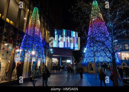 Giant Christams tree at Liverpool One reflected in shop windows - Stock Photo