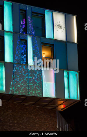 Giant Christmas tree at Liverpool One reflected in shop windows - Stock Photo