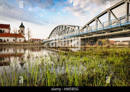 View at bridge over the narew river nearby church in Tykocin. Podlachia, Poland. - Stock Photo
