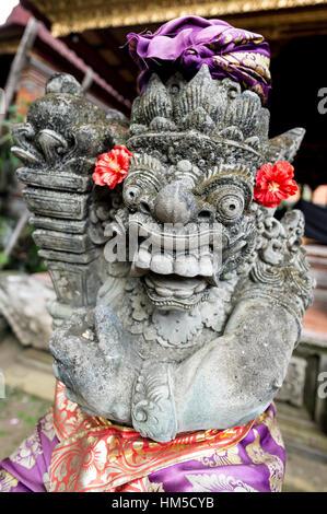 Temple Guardian, frightening statue in front of Ubud Palace, Ubud, Bali, Indonesia - Stock Photo