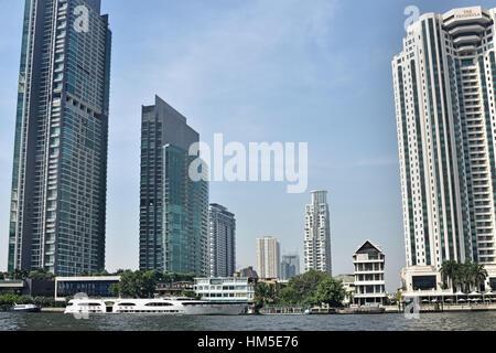 Traffic on the Chao Phraya River and Bangkok skyline Thailand - Stock Photo