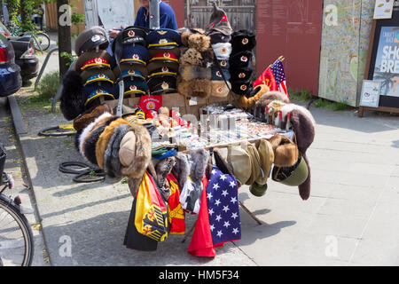 BERLIN, GERMANY - MAY 23, 2014: Sale stand of Soviet and DDR militaria near Checkpoint Charlie in Berlin, Germany. - Stock Photo