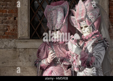 VENICE - FEB 5, 2013: Costumed people on the Piazza San Marco during the Venice Carnival. - Stock Photo
