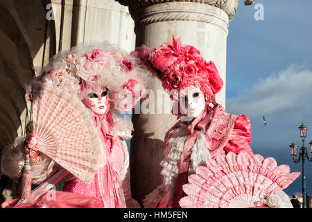VENICE - FEB 6, 2013: Costumed people on the Piazza San Marco during the Venice Carnival. - Stock Photo