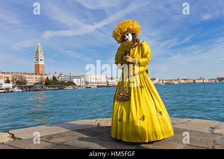 VENICE - FEBRUARY 7: Costumed woman with the Piazza San Marco in the background during Venice Carnival on February - Stock Photo