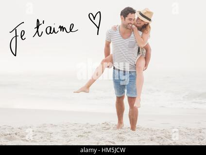Digital composite image of man giving piggy back to woman at beach - Stock Photo