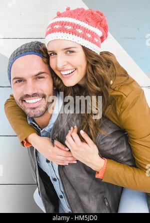 Portrait of happy man giving piggy back to woman - Stock Photo