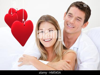 Couple embracing each other against white background - Stock Photo