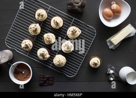 High angle view of cupcakes with eggs on table - Stock Photo