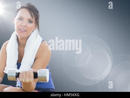 Fit woman exercising with dumbbell - Stock Photo