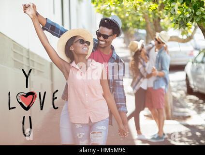 Happy couple dancing on street - Stock Photo