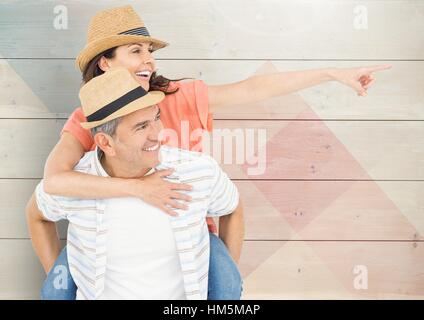 Composite image of mature man giving piggy back to woman - Stock Photo