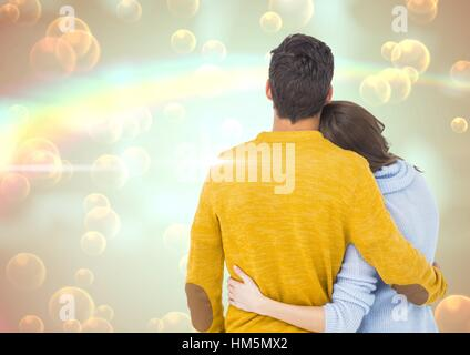 Couple embracing each other against digitally generated background - Stock Photo