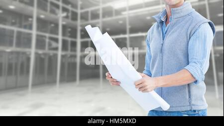 Mid section of construction engineer holding a plan - Stock Photo