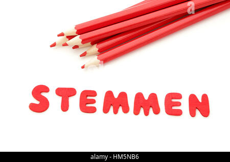 Red pencils and the word stemmen which means to vote in dutch for the upcoming elections on march 15, 2017 in the - Stock Photo
