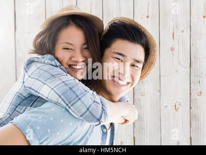 Portrait of man giving piggy back to woman - Stock Photo