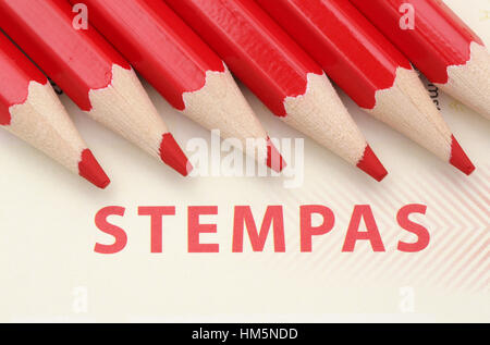 Red pencils on a stempas which means a voting form in dutch - Stock Photo
