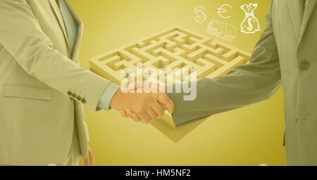 Businessman and woman shaking hands outside maze with money symbols - Stock Photo