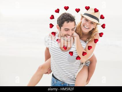 Composite image of man giving piggy back to woman against hearts in background - Stock Photo
