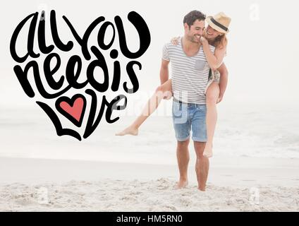 Happy man giving woman piggyback on beach - Stock Photo