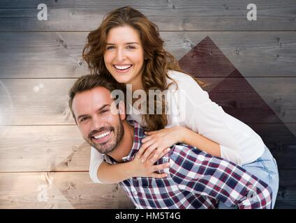 Man giving woman piggyback - Stock Photo