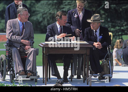 United States President George H. W. Bush hands a ceremonial pen to Justin Dart after he signed the Americans with - Stock Photo