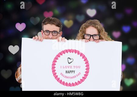 Digitally generated image of nerd couple holding placard with valentines message - Stock Photo